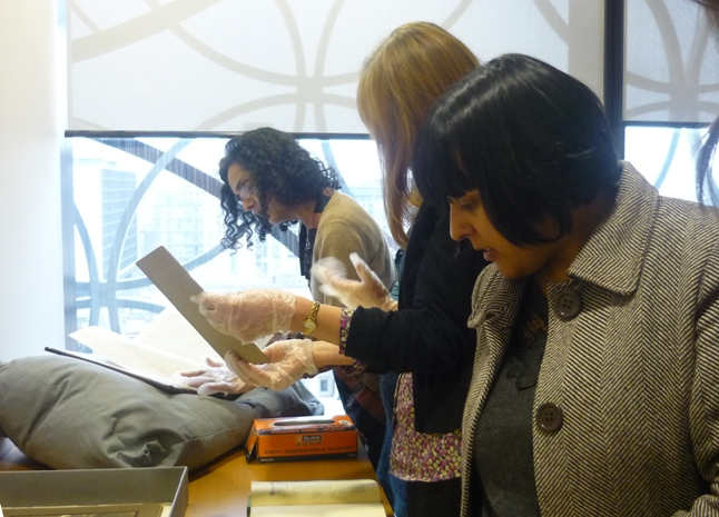 Participants looking at archives in Library of Birmingham